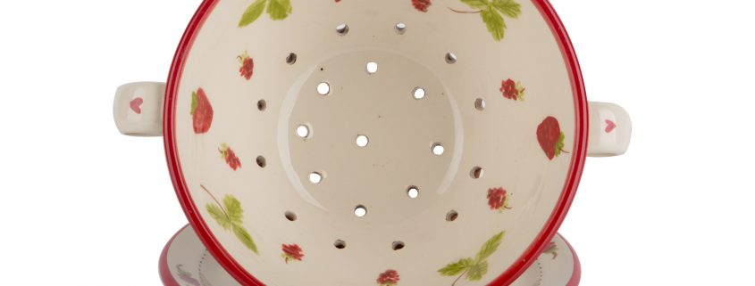 A photo of a hand-made ceramic Colander by Kate Hackett