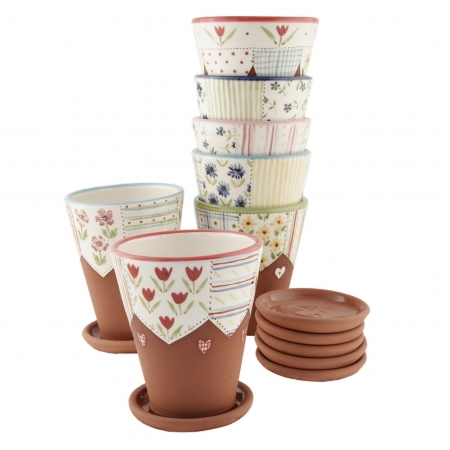 A photo of a collection of handmade decorative floral patchwork style planters with saucers.