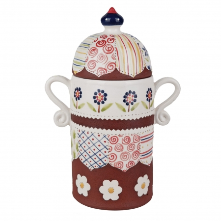 A photo of a handmade ceramic storage jar with intricate decoration