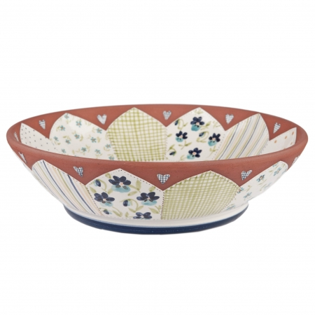 A photo of a handmade ceramic floral Bowl