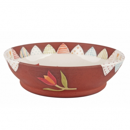 A photo of a handmade ceramic folk art design pasta bowl