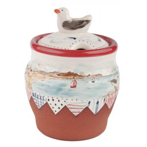 A photo of a handmade ceramic seaside design storage jar with seagull handle