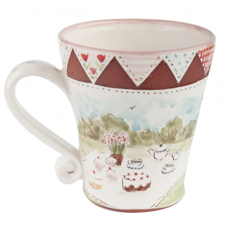 A photo of a handmade ceramic garden design mug