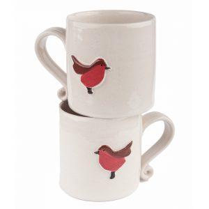 A photo of two handmade ceramic Childrens white robin design mugs
