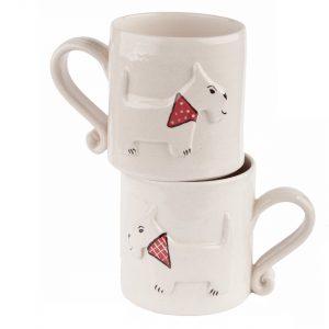 A photo of two handmade ceramic Childrens white dog design mugs