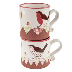 A photo of two small bird design mugs with patchwork effect