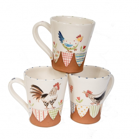 A photo of three handmade patchwork design chicken mugs.