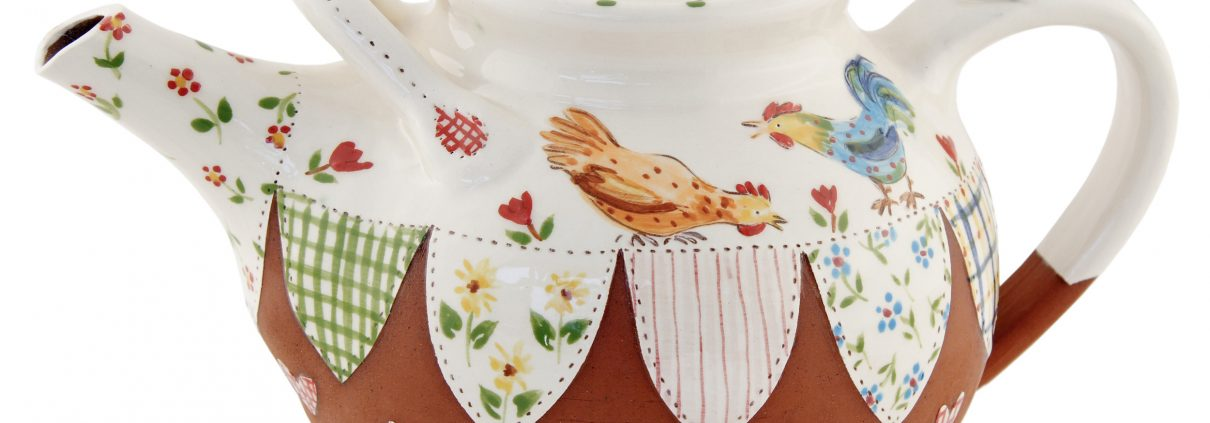 A photo of a large handmade Chicken teapot