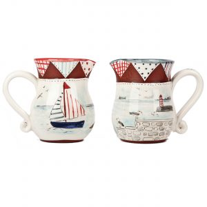 A photo of two handmade ceramic Seaside design jugs