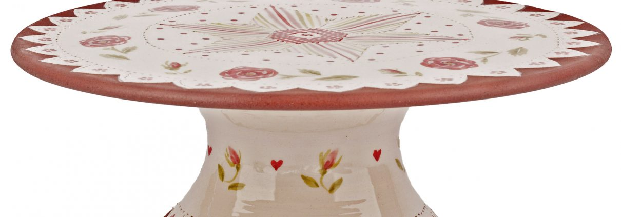 A photo of a handmade ceramic Floral rose themed cake stand