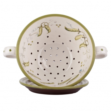 A photo of a handmade ceramic Colander and plate set