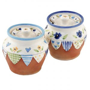 A photo of a handmade ceramic Small floral lidded jar