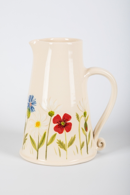A photo of a Ceramic Jug with red poppy and meadow flowers on the side
