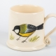 A photo of a small white mug with a Great Tit Garden Bird on the side
