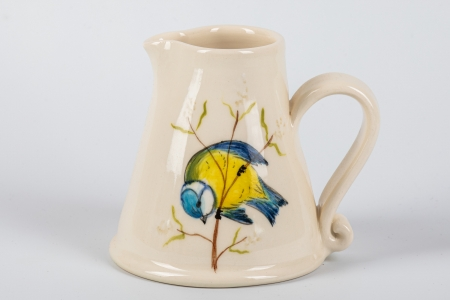 A photo of a small white jug with a Blue Tit Garden Bird on the side