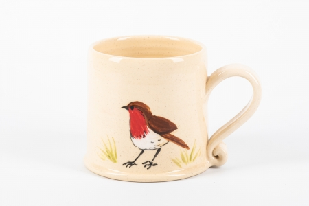 A photo of a white mug with a robin garden bird on the side