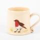 A photo of a white mug with a robin garden bird on the side