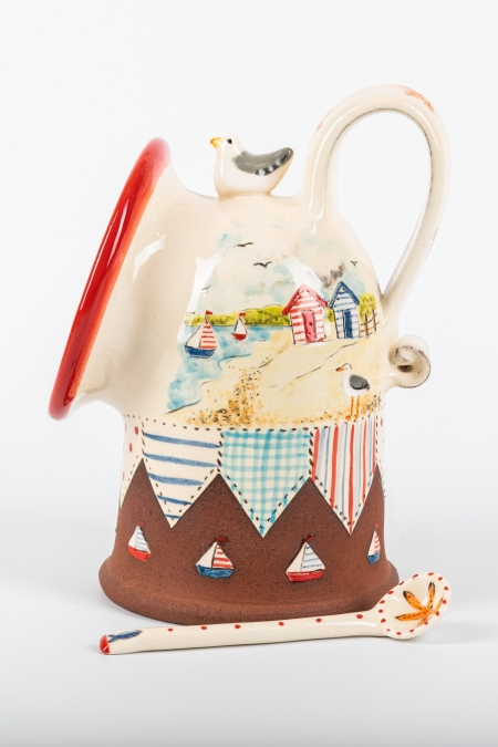 A photo of a salt pig with patchwork and seaside decoration