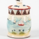 A photo of a garlic jar with patchwork and seaside decoration