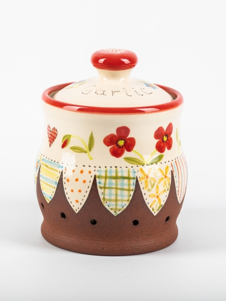A photo of a ceramic garlic pot with poppies on the side and effect patchwork decoration