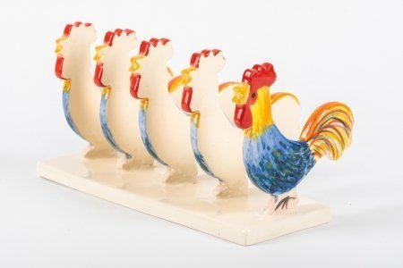 A photo of a hand made ceramic toast rack decorated and shaped from 5 chicken shapes