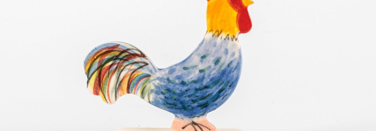 A photo of a Ceramic stand up decoration in the shape of a chicken