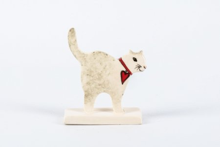 A photo of a Ceramic stand up decoration in the shape of a cat