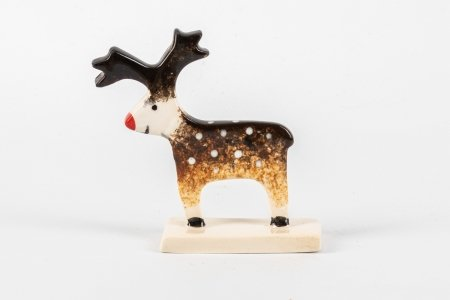 A photo of a Ceramic stand up decoration in the shape of a reindeer
