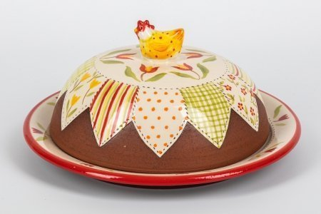 A photo of a hand made ceramic butter dish with a ceramic chicken shaped handle and patchwork decoration