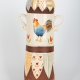 A photo of a decorative ceramic Pasta Jar with two-tone/patchwork design with a chicken on the side