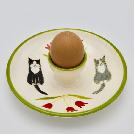 A photo of a cat design childrens egg plate