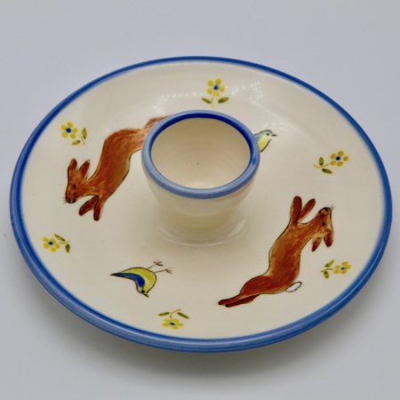 A photo of a rabbit design childrens egg plate