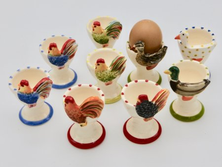 A photo of a selection of colourful animal ceramic egg cups