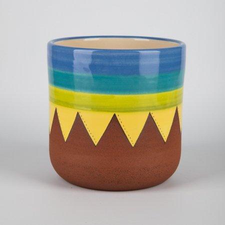 A photo of a hand made ceramic 70s design plant pot